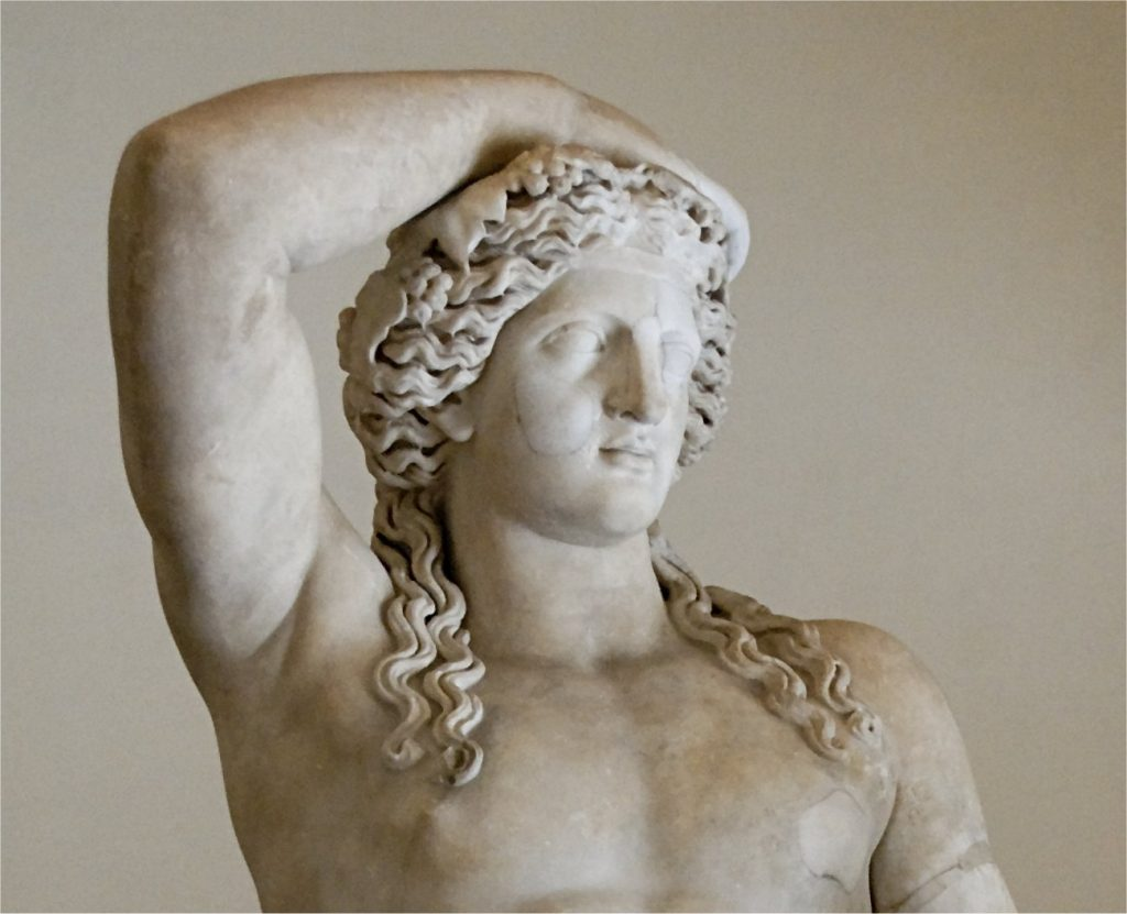 Statue of Dionysus with long curly hair